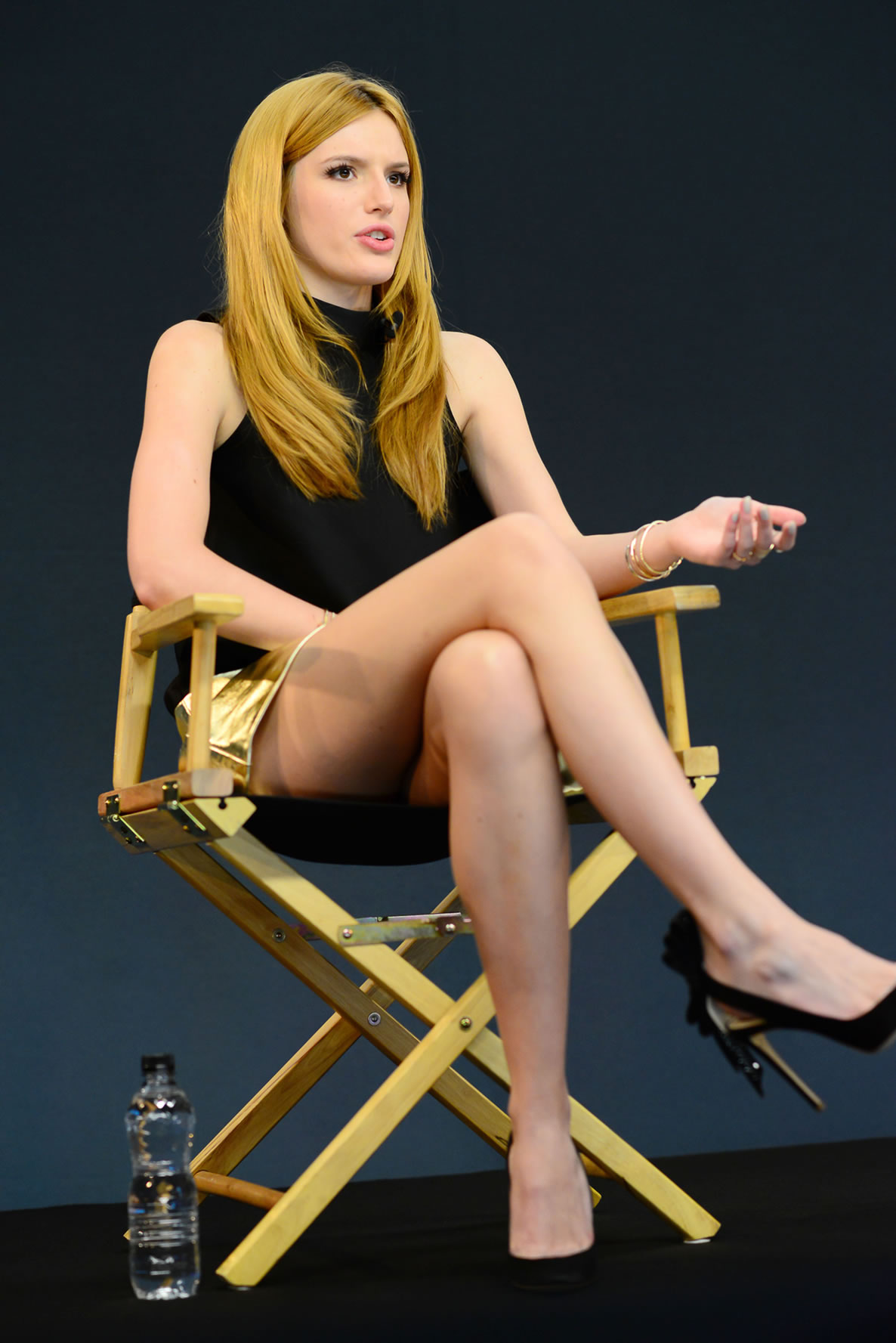 Ashley James shows off her legs in tiny denim mini skirt